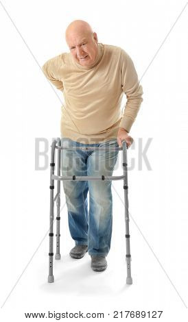 Elderly man with walking frame on white background
