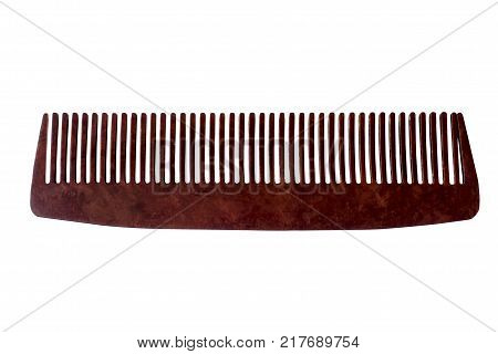 Comb of hair isolated on white background. Brown comb