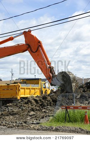 Danger Mechanical Digger And Truck At Work