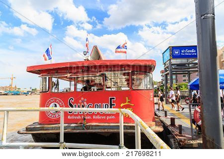 Bangkok Thailand - August 13 2017 : The Chao Phraya River Ferry is docking waiting for passenger at Tha Wang Lang waterfront in Bangkok Thailand.