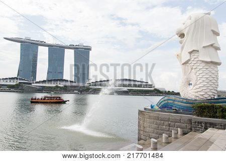 Singapore May 10 2017 : Merlion statue fountain with Marina bay sand background. Merlion fountain and Marina bay sand are the most famous tourist attraction in Singapore.