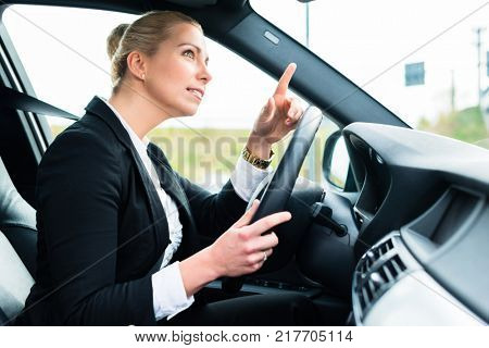Woman driving car being angry cursing other driver