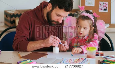 handmade child present father support concept. life of happy parents. hobby of little princess. family values.