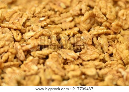 Background with stack of dried and peeled walnuts