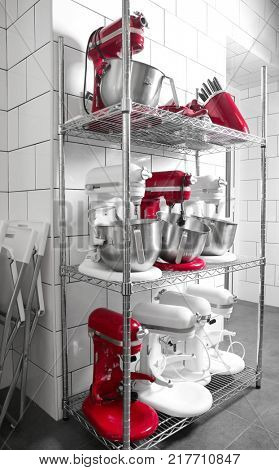Shelving with kitchen utensils and cutlery in bakery