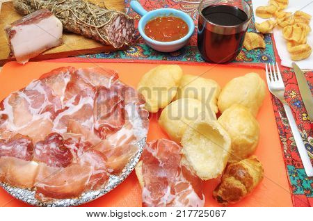 Aperitif and dinner in a tavern with salami and fried dumplings
