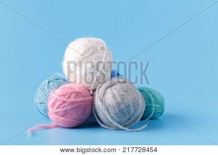 Leisure Hobby Concept, Clew Of Natural Wool On Blue Background