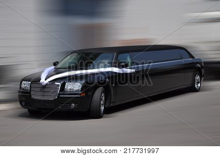 Isolated Black limousine moving in urban environment