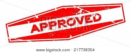 Grunge red approved hexagon rubber seal stamp on white background