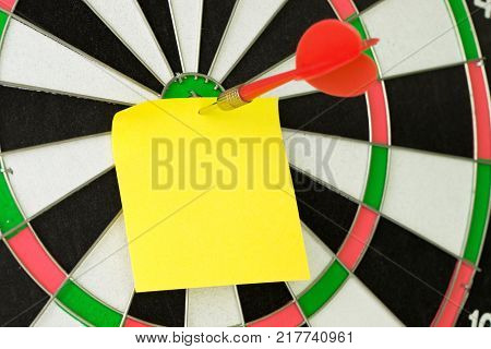 Blank Sticky Note On Dartboard With Dart