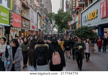 Wuhan Hubei China, 10 December 2017: Street view of Jianghan lu road the biggest pedestrian shopping street of Wuhan in China