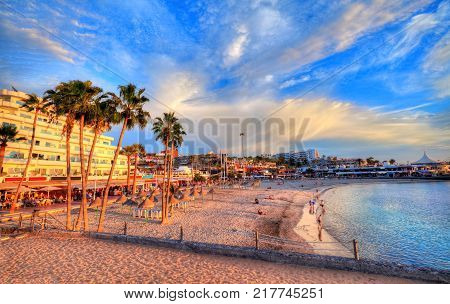 Beautiful view over Pinta beach at sunset with colorful water and sky illuminated by sunshine, in Tenerife - Canary island Spain