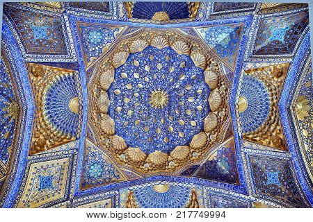 SAMARKAND, UZBEKISTAN - MAY 04, 2014 Golden interior of Aksaray mausoleum