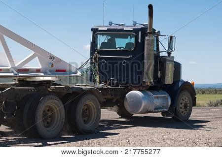 Utah USA - June 02 2015: Freight truck carries out an inversion maneuver. Camion on road. Utah USA June 02 2015