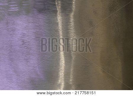 Metal background, texture of titanium, sheet of metal surface. iridescence. Heat tint, variety of colors, violet, purple