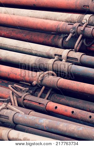 Metal props, closeup. Stacked on construction site. Background