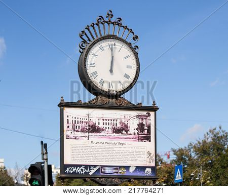 Bucharest Romania October 10 2017 : Large clock with arrows on the Revolution Square in Capital city of Romania - Bucharest