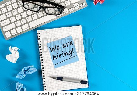 We are hiring - note on notepad at your new job and workplace. Job board design, template.