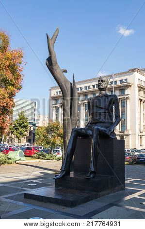 Bucharest Romania October 10 2017 : An abstract statue standing in the Revolution Square in Capital city of Romania - Bucharest