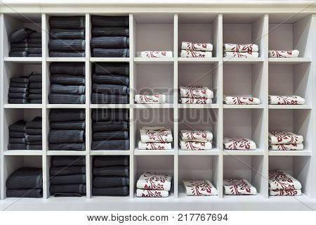 Clean towels assorted colors every day in a square white shelf.