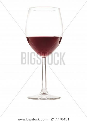 Glass of glass burgundy wine close-up on white isolated background. Side view