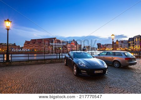 GDANSK, POLAND - DECEMBER 8, 2017: Scenery of Gdansk near Motlawa river at night, Poland. Gdansk is the historical capital of Polish Pomerania with gothic architecture.