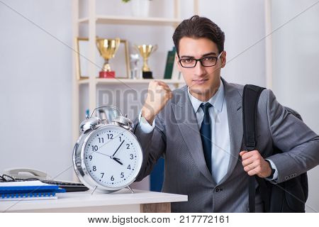 Young businessman rushing to sports gym during break