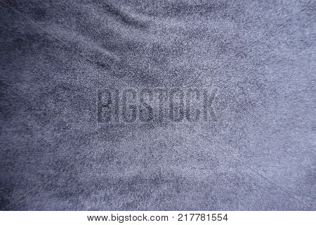 Subdued blue artificial suede fabric surface from above