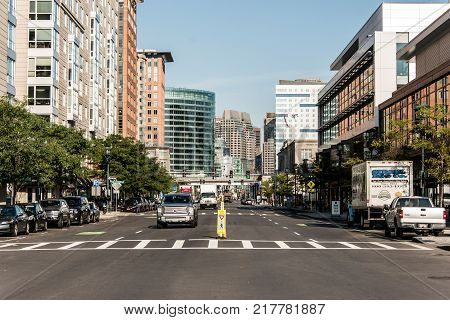 Boston MA USA 04.09.2017 skyline in summer day, panoramic view on buildings in downtown and road Street with traffic at waterfront side