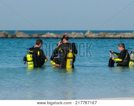 a group of divers preparing to immerse in the Persian Gulf in the suburbs of Dubai UAE