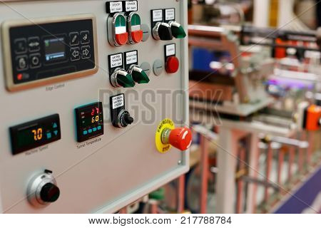 Control panel of the automatic production line - MDF or chipboard panel lamination machine. Selective focus.