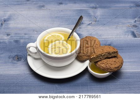Tea With Lemon Slices And Spoon As Oar.