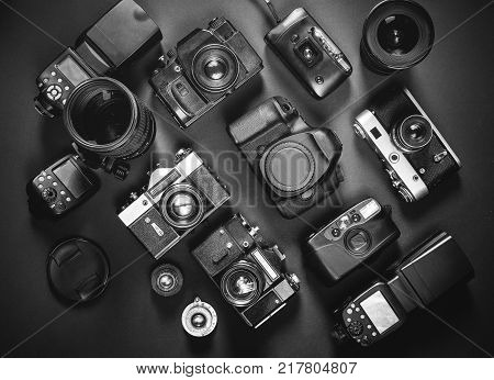 Collection Vintage Film And Digital Cameras On Black Background Top View