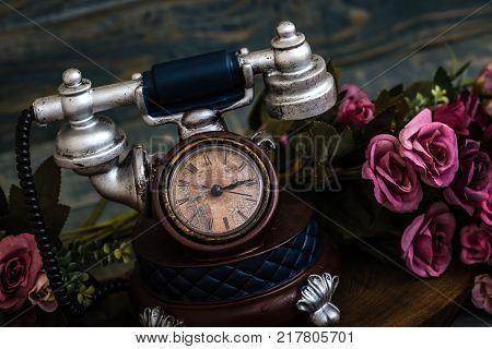 Desk Clocks With Antic Telephone Shape On Blue Background