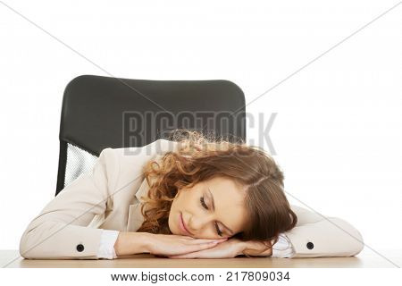Businesswoman having a nap at her desk. poster