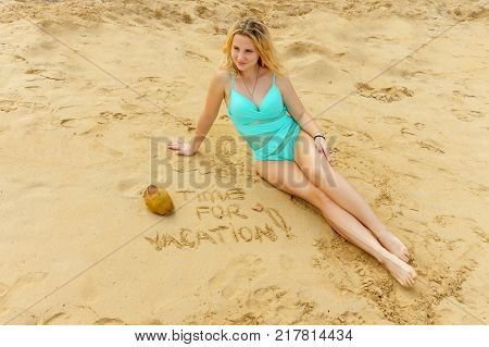 exotic vacation. Dominican republic written on the sand