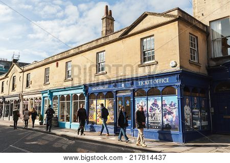 Bath United Kingdom - November 2 2017: Old street view of Bath Somerset. Ordinary people and tourists walk the street near Bath Rugby Ticket Office