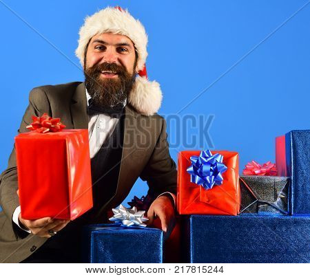 Businessman With Cheerful Face And Stack Of Boxes