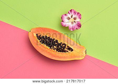Papaya Tropical Fruit. Vanilla Pastel. Bright Sweet Color. Flat lay. Trendy fashion Style. Minimal. Orange Papaya with Pink Flower. Detail, Art gallery