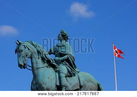 Statue of Frederick V by Jacques Franancis Joseph Saly at the centre of the Amalienborg Palace Square in Copenhagen Denmark