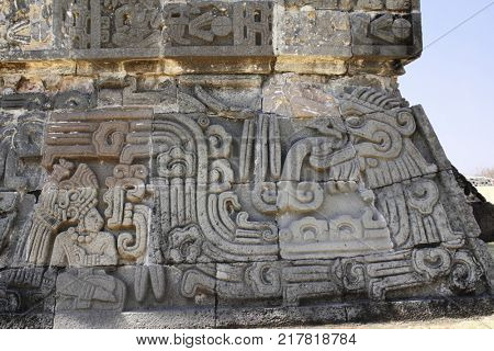 Bas-relief carving with of a american indian chieftain and god Quetzalcoatl, pre-Columbian Maya civilization, Temple of the Feathered Serpent in Xochicalco, Mexico. UNESCO world heritage site
