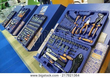 MOSCOW, AUG. 22, 2017: View on exhibition stand with new sets of maintenance and repair tools in plastic boxes. Car repair tools boxes. Car repair tools sets. New tools sets devices equipment