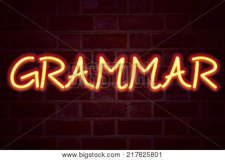 Grammar neon sign on brick wall background. Fluorescent Neon tube Sign on brickwork Business concept for  The Basic Rules of Syntax Grammatical Language 3D rendered Front View