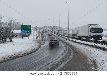 Hemel Hempstead UK - December 10 2017: Traffic on the junction 9 motorway M1 during the snowstorm