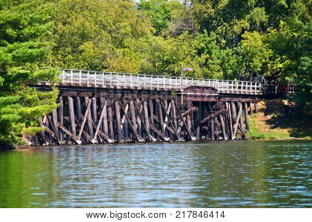 Rustic wooden trestle across the Bearskin State Trail in Minocqua Wisconsin