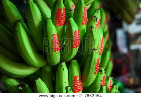 BANANA FOR OFFERING. In Chinese tradition, banana is considered as a sacred offering fruit to the lord Buddha. Each banana will have a red Chinese symbol - meaning DOUBLE HAPPINESS, pasted on. This symbol is also used for wedding ceremony, and festival.