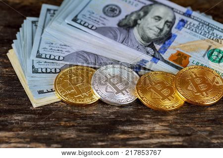 Golden bitcoin coins on a paper dollars . Virtual currency. Crypto currency. New virtual money Dollars money. Lens flare coin bitcoin dollars graphic card internet wire