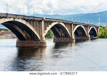 Communal bridge across the Yenisei river in Krasnoyarsk Siberia. Russia