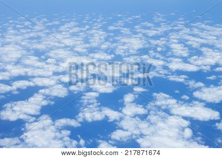 cloud scape on blue sky background from airplane window