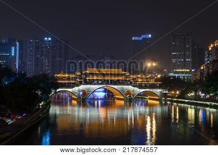 CHENGDU CHINA - NOV 24: Anshun Bridge Light Up at Night in Chengdu China Nov 24 2017